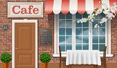picture of awning  - Facade of a traditional cafe with a window door awnings - JPG