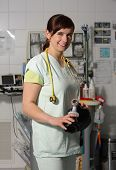 pic of icu  - Portrait female nurse in ICU in the green uniform with breathing bag - JPG