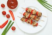 picture of turkey dinner  - Traditional turkey kebab skewer barbecue meat with vegetables and sauce on white dish - JPG