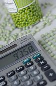 Neatpickes wokplace with peas, pea tin and calculator