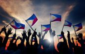 pic of filipino  - Group of People Waving Filipino Flags in Back Lit - JPG