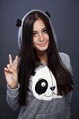 picture of pandas  - charming girl dressed as a panda shooting in studio - JPG