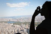picture of inhalant  - Asthmatic brunette using her inhaler against new york - JPG