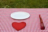 picture of glass heart  - White porcelain plate red glass vase and red heart set on a red - JPG