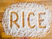 image of rice  - Rice word made of rice on wooden board - JPG