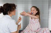 pic of ten years old  - Smiling young girl of ten years old brushing teeth - JPG