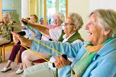 Elderly Ladies Exercising In A Gym poster