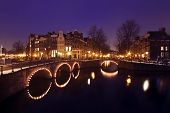 Cityscenic in Amsterdam innercity in the Netherlands at night