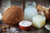 Coconut Oil And Milk, Grounded Coconut Flakes And Fresh Coco Nut. poster