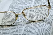 Glasses And Dictionary