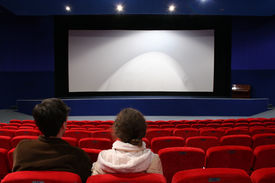 stock photo of movie theater  - a loving couple in the emty cinema auditorium - JPG