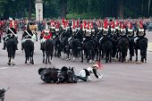 LONDON - JUNE 11: Royals horse Guard falls off horse at Trooping the Color ceremony in London, Engla