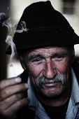 Closeup Artistic Photo of Aged Man With  Grey Mustache Smoking Cigarette poster