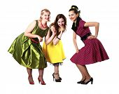 foto of poodle skirt  - three stylish young woman in bright colour dresses - JPG