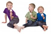 Three Funny Kids Eating Ice Lolly