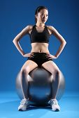 Sexy Young Asian Woman In Balance Ball Exercise