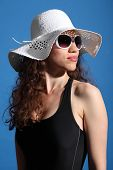 Beautiful Woman In Hot Sun Swimsuit Shades And Hat
