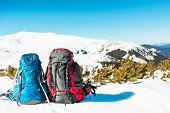 Two Backpacks On The Snow. poster