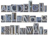English alphabet set - a collage of 26 isolated letters in letterpress metal type printing blocks, a poster