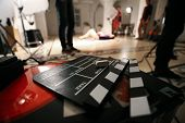 Film Movie Background, Clapperboard And Video Light In A Studio poster
