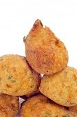 a few cod fritters on a white background