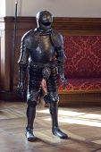 stock photo of castration  - Armored medieval knight guard in old palace - JPG