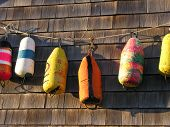 Fisherman Buoys Against Fishing Shed