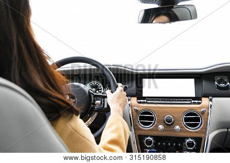 poster of Woman Hands Holding Car Steering Wheel Of A Modern Car. Hands On Steering Wheel Of A Car Driving. Gi