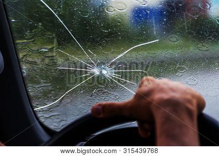 poster of Broken Windshield Of A Car. A Web Of Radial Splits, Cracks On The Triplex Windshield. Broken Car Win
