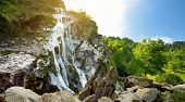 Majestic Water Cascade Of Powerscourt Waterfall, The Highest Waterfall In Ireland. Tourist Atraction poster