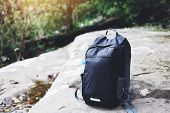 Backpack On Nature With Bottle For Backpacker Hiker On The Rock In The Forest On The Mountain poster