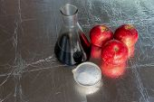 Agriculture Chemical In Fruits. Close Up Of Apples Next To Fertilizers In Powder And Lab Glassware. poster