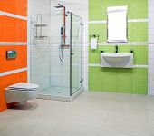 image of lavabo  - Contemporary bathroom with green and orange ceramics - JPG