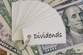 Dividends, Return Or Earning That Pay From Stock Or Mutual Fund Investing Concept, Lot Of Paper Note poster