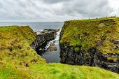 Narrow Sea Inlet Between The Rocks Of A Cliff In The Coastal Walk Route From Doolin To The Cliffs Of poster