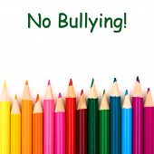stock photo of school bullying  - A pencil crayon border isolated on white background with words No Bullying - JPG