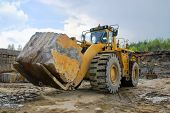 foto of oversize load  - Excavation with a big stone in a granite quarry - JPG