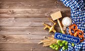 Rustic background for Oktoberfest with white and blue Bavarian fabric, beer glass, wheat, hop, pretz poster