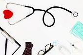 Stethoscope, Top View Of Doctors Desk Table, Blank Paper On White Background, Above View Doctor Wor poster