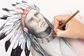 Man Hand Drawing Pencil Picture With American Indian Chieftain