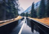 Road In The Autumn Forest In Rain With Motion Blur Effect. Perfect Asphalt Mountain Road In Overcast poster