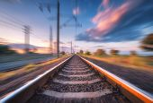 Railroad And Beautiful Blue Sky With Clouds At Sunset With Motion Blur Effect In Summer. Industrial  poster