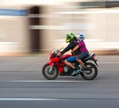 Motorcyclist In Motion Riding Down The Street . Intentional Motion Blur poster