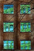 Reflection Of Colourful Building In Windows Of Old Block