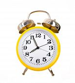 stock photo of daylight-saving  - Several brightly colored traditional alarm clocks thrown on a white background - JPG
