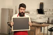 Secret Tips. Useful Information. Man Bearded Hipster Red Apron Stand In Kitchen. Kitchen Furniture S poster