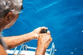 Elderly Man On A Yacht Holding A Sea Urchin. Beautiful View From A Yacht At Blue Color Seaward. Sail poster