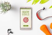 Healthy Goals Concept. Fitness Healthy Goals With Mockup Mobile Phone On White Table With Dumbbells, poster