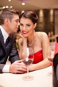 couple flirting in restaurant, passion love