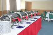 foto of chafing  - photograph of plates cutleries and chafing dish at catering buffet - JPG